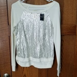 NWT Hollister cream and silver top.  Size small